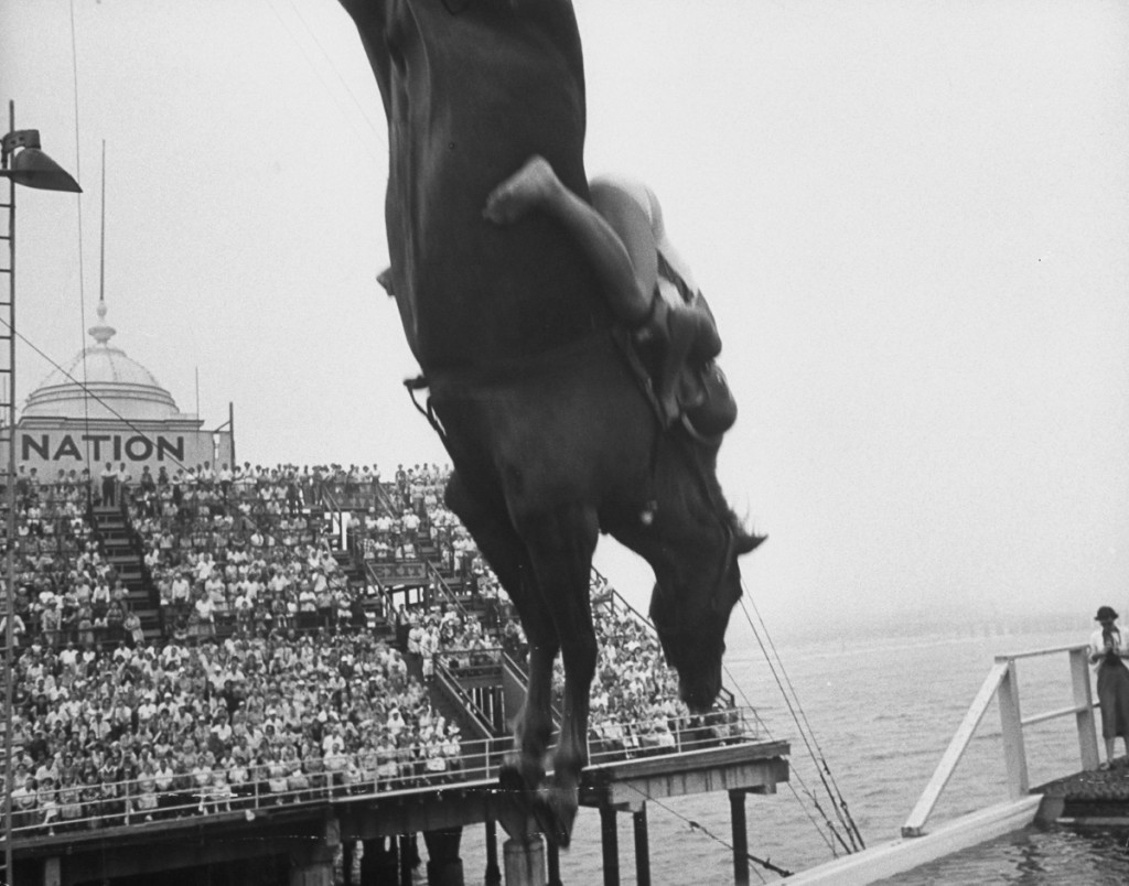 People come out to see the diving horse.  (Photo by Peter Stackpole/The LIFE Picture Collection/Getty Images)