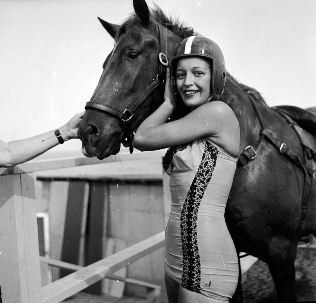 circa 1955:  Dinah, a diving horse stands with her rider just after a dive.  (Photo by Three Lions/Getty Images)