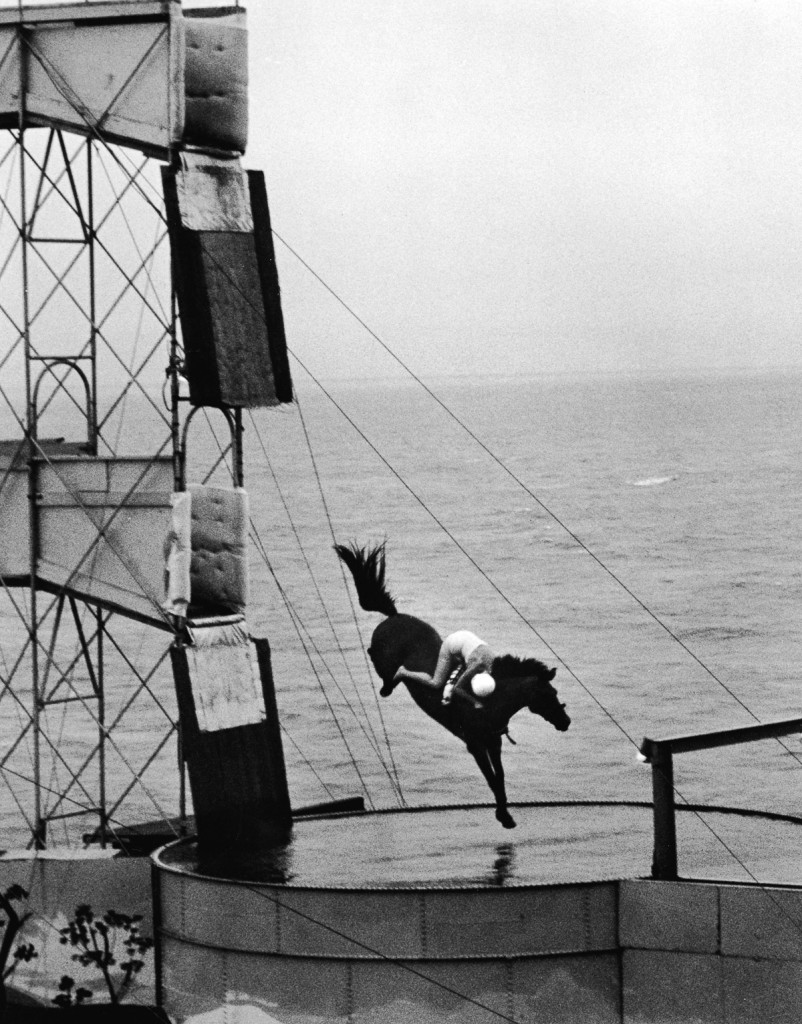 A rider on horseback performs a stunt high-dive into a swimming pool, 1940s. (Photo by Frederic Lewis/Getty Images)